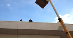 Redline Fire Protection - Cathedral City, CA. Lifting of new exhaust fan