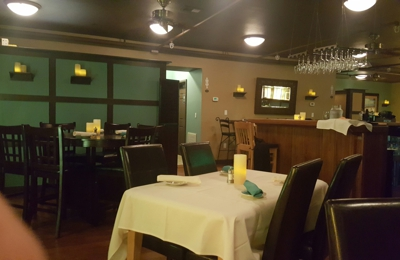 Up The Stairs - Apalachicola, FL. Nice atmosphere,  great service and healthy portions.  5 Stars