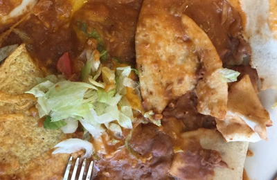 La Frontera Cafe - Salt Lake City, UT. A been combination plate. When it was to be a chicken burrito, chicken enchiladas and chicken taco.  Simply Awful. Not authentic at all..