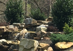 Maples Ridge Cabin Rentals - Sevierville, TN. Water fall at Creekside Lodge in pigeon forge