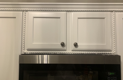 Landon's Painting and Pressure Washing - Ocala, FL. Crooked and poorly painted cabinets