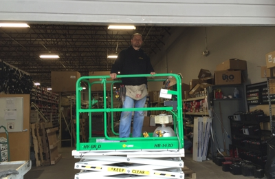Accurate Electrical Contractors. Upgrading the lighting system at a auto parts warehouse.