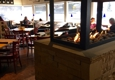 Squatters Roadhouse Grill & Pub. - Park City, UT. Cozy Fireplace in The Middle of The Room