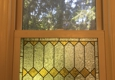 Feldman Stained Glass - Jersey City, NJ. Reproduction installed within existing double hung sash