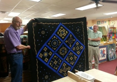 Austin Sewing Machines & Quilts - Round Rock, TX. Bob and Mike with an award winning quilt