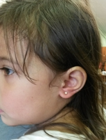 Julissa from Franklin Square - ear piercing without tears .. left laughing