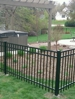 Backyard with wrought iron fence