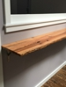 Live edge reclaimed wood oak shelf for a client in Minneapolis.