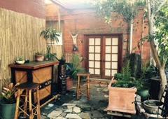 City of Paris Studios - Emeryville, CA. Tiki bar in City of Paris shared garden courtyard