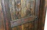 "Barn wood door made from hand hewn ""skins""."