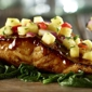 Longhorn Steakhouse. Our fresh Atlantic Salmon marinated in a sweet ginger-garlic soy sauce, then topped with fresh pineapple salsa.