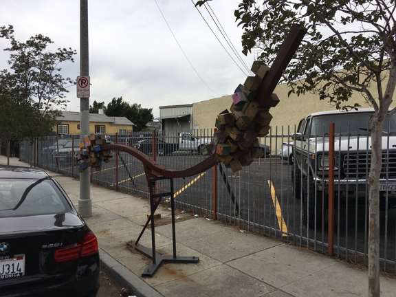 Victory Powder Coating & Sandblasting  Inc. - Los Angeles, CA. Strung along wood and metal art installation near Nintendo controllers and Rubik's cube installations at the corner of Broadway and 58th Street.