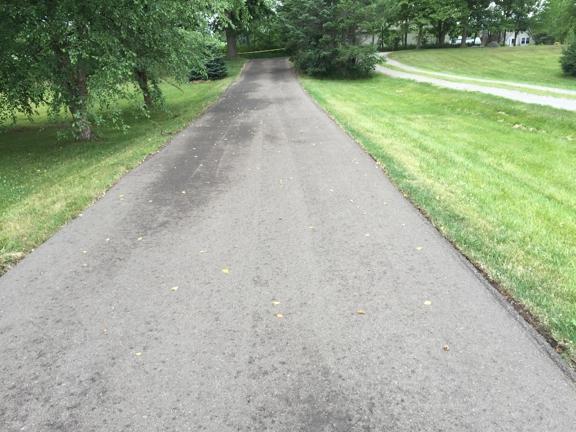 T Burkes Asphalt & Concrete Paving - Ann Arbor, MI. Out front, down toward the road
