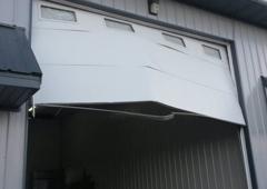 Adams Door Inc.   Cedar Rapids, IA. Damaged Overhead Door