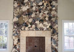 Christa's South Seashells - West Palm Beach, FL. 20' H wall paneling on Nantucket Island home fireplace wall.  Fancy Corals, Fossils, Sea Fans and exotic shells
