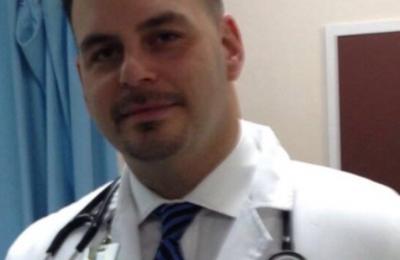 Dr Juan C Arroyo DMD - Miramar, FL