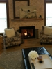 Real stone fireplace fascia, log mantel and wide plank tile floor.