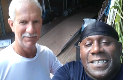 Americas Movers Inc. - Davie, FL. Mr. Edwards with driver Kenneth after a stress free move!