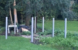 Fence posts placed on my neighbor's property (in mid-Summer)