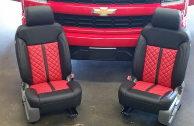 Upholstery Limited - Baton Rouge, LA. 2016 Silverado: Black leather interior, Red Platini inserts, black stripe, and contrasting stitch. Red door panel inserts.