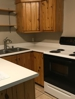 Knotty pine cabinets & a dishwasher, too!