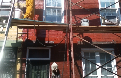 Higgins Cement - Philadelphia, PA. Remove paint clean bricks grind out cement joints breakpoint paint corners call window restoration front of house