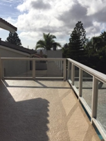 New waterproof deck with glass railing - Delphi Construction