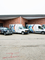 New Life Property Restoration's Fleet of service vehicles