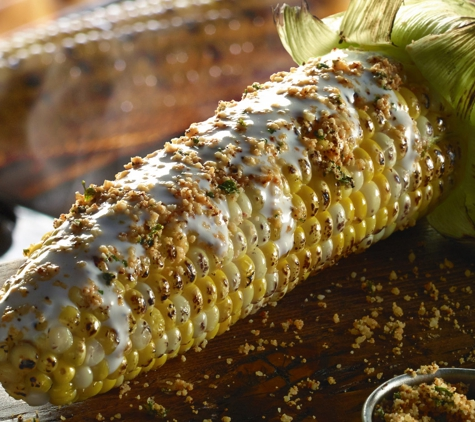 Longhorn Steakhouse. Fire-grilled sweet corn from GloriAnn Farms, brushed with housemade crema and topped with Parmesan cheese.